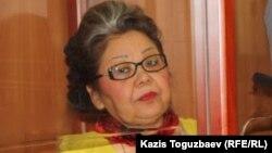 Бывшая судья Кульпаш Утемисова участвует по видеконференции в заседании апелляционного суда в Астанинском городском суде, на котором рассматривается ее жалоба. Алматы, 4 июля 2014 года.