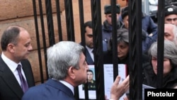 Armenia -- President Serzh Sarkisian talks to protesting parents of soldiers who died in non-combat incidents, 27Jan2011.