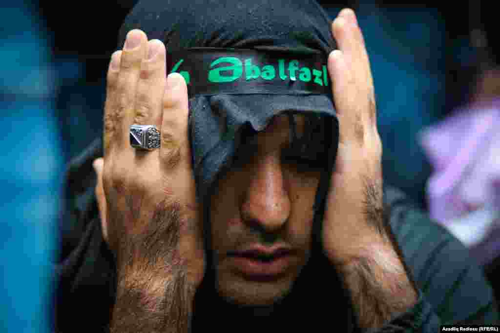 A Shi'ite worshiper at Ashura commemorations in Baku.