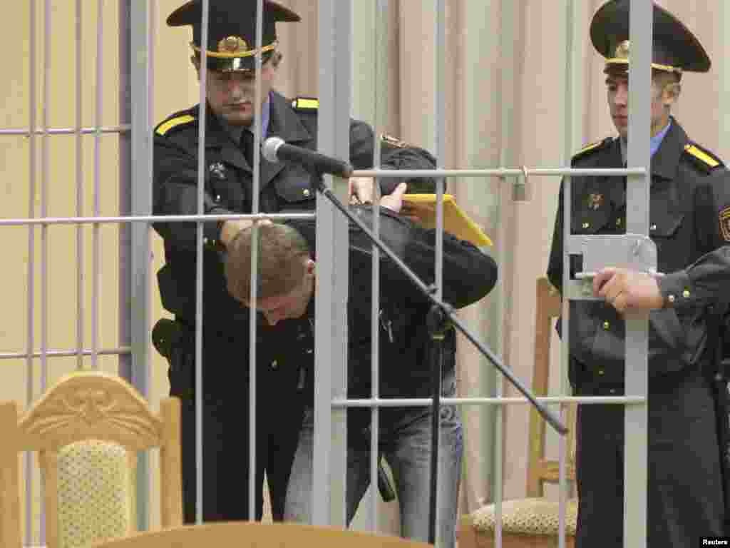 Vladislav Kovalyov is led into a holding cage before a court hearings in Minsk. Kovalyov is accused of preparing and carrying out the deadly bomb attack in the Minsk subway in April. (Photo by Vasily Fedosenko for Reuters)