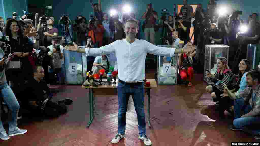 Ukraine's biggest pop-music starSvyatoslav Vakarchuk poses for a picture at a polling station in Kyiv. He leads the party Holos, which espouses a strong pro-Western, pro-European ideology. President Zelenskiy's Servant Of The People party could make Holos a coalition partner in parliament. (Reuters/Gleb Garanich)