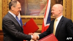 British Foreign Secretary William Hague (right) and Russian counterpart Sergei Lavrov today in London
