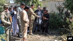 Security forces investigate an explosion that killed Abdul Jabar Qahraman, a candidate in parliamentary elections, at his home in Lashkar Gah, the capital of the southern Helmand Province, on October 17, 2018.