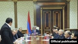Armenia -- Prosperous Armenia Party leader Gagik Tsarukian (L) joins the National Security Council at a meeting chaired by President Serzh Sarkisian, 22Apr2011.