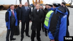 Russian President Vladimir Putin inspects the site of the under-construction bridge across the Kerch Strait to Crimea on March 18.