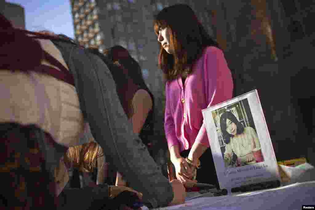 A photo of Boston Marathon bombing victim Lu Lingzi, a Boston University graduate student and Chinese citizen, is seen outside the Boston University Marsh Chapel before her memorial service in Boston, Massachusetts, on April 17, 2013.