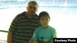 Павел Шеремет с сыном Колей