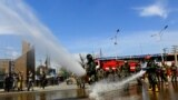 Afghan National Army (ANA) soldiers spray disinfectant in the eastern city of Jalalabad to prevent the spread of the coronavirus disease (COVID-19) on April 9.
