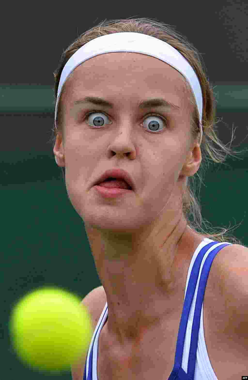Slovakia's Anna Schmiedlova eyes the ball for a return against Australia's Samantha Stosur during their first-round match at the Wimbledon tennis tournament. Stosur won 6-1, 6-3. (AFP/Carl Court)