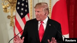 U.S. President Donald Trump gestures during a joint news conference with Japan's Prime Minister. May 27, 2019