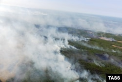 A 2011 file photo of fires smoldering across the wilderness of the Sakha region.