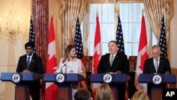Secretary of State Mike Pompeo, second from right, with Defense Secretary Jim Mattis, right, and their Canadian counterparts Canadian Minister of Foreign Affairs Chrystia Freeland and Canadian Minister of Defense Harjit Sajjan, left, speaks to reporters d
