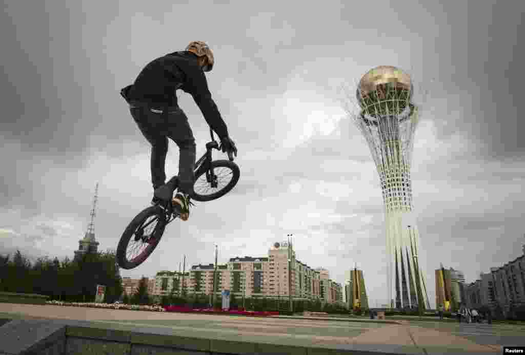 A teenager in Kazakhstan rides a bicycle in the capital, Astana. (Reuters/Shamil Zhumatov)