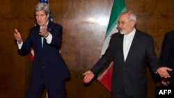 U.S. Secretary of State John Kerry (left) and Iranian Foreign Minister Mohammad Javad Zarif during a round of nuclear negotiations in Montreux, Switzerland, on March 2