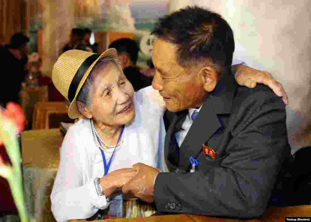North and South Korean family members meet during a reunion at North Korea's Mount Kumgang resort, near the demilitarized zone, on August 20. (Reuters)