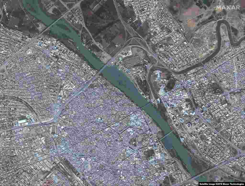 These satellite images show Mosul, Iraq on November 13, 2015, before IS militants invaded the city and the same area on July 8, 2017, after IS destroyed much of this part of the city.