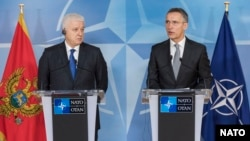 NATO Secretary-General Jens Stoltenberg (right) and Montenegrin Prime Minister Dusko Markovic