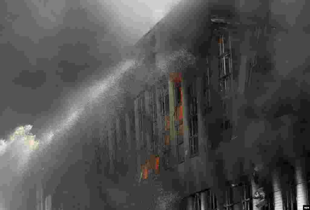 "Firefighters extinguish a fire in a former ""ZIL"" automobile factory in Moscow on July 8."