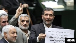 Parliamentary deputies blamed the fatal February 14 demonstration on Musavi and Karrubi.