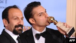 Director Asghar Farhadi (left) and actor and screenwriter Peyman Moaadi pose with their Golden Globe for best foreign language film.
