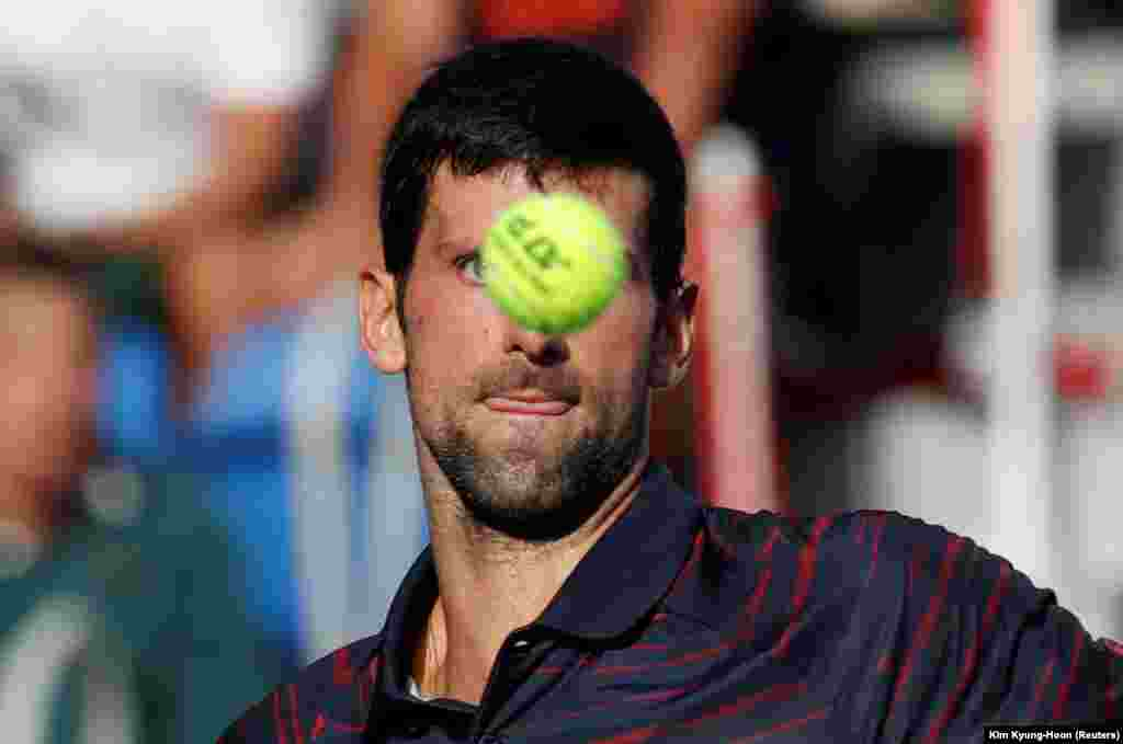 Serbian tennis player Novak Djokovic gears up to hit the ball in a quarter-final match against France's Lucas Pouille at the Japan Open in Tokyo on October 4. (Reuters/Kim Kyung-Hoon)
