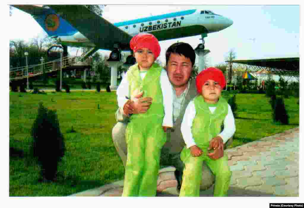 Rights activist Chuyan Mamatkulov, imprisoned in Navoi, photgraphed with his two children in Kashkadarya Province.