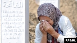 A Bosnian woman weeps over the grave of one of the victims of the Srebrenica massacre.