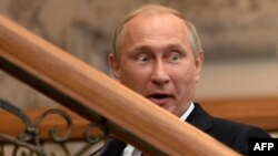 Belarus -- Russia's President Vladimir Putin reacts during a meeting in the Belarussian capital Minsk on August 26, 2014.