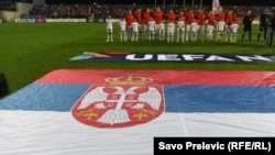 Serbia's national soccer team takes a group photo ahead of a match in Podgorica, Montenegro.