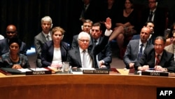 Vitaly Churkin, Russia's ambassador, to the United Nations, votes to veto on a draft resolution for establishing a tribunal to prosecute those responsible for the MH17 crash during a Security Council meeting in New York on July 29.