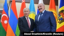Орус президенти Владимир Путин жана беларус президенти Лукашенко.
