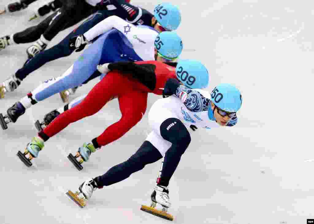 Russia's Viktor Ahn (right to left) leads Han Tianyu of China, Vladislav Bykanov of Israel, and Park Se-yeong of South Korea during the heat 2 in men's 1500 meters of the short-track competitions in the Iceberg Skating Palace. Ahn won bronze.