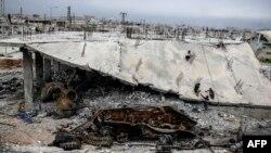 В одном из районов города Кобани, разрушенного войной, 29 марта 2015 г.