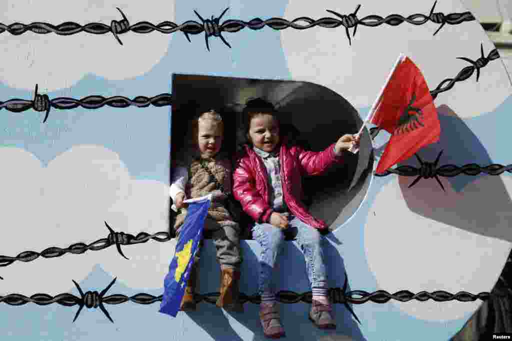 Children wave Albanian (right) and Kosovo flags during celebrations marking the eighth anniversary of Kosovo's declaration of independence from Serbia, in Pristina, on February 17. (Reuters/Marko Djurica)