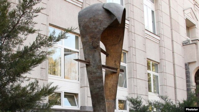 Armenia -- A statue symbolizing the national currency, the dram, outside the Central Bank building in Yerevan.