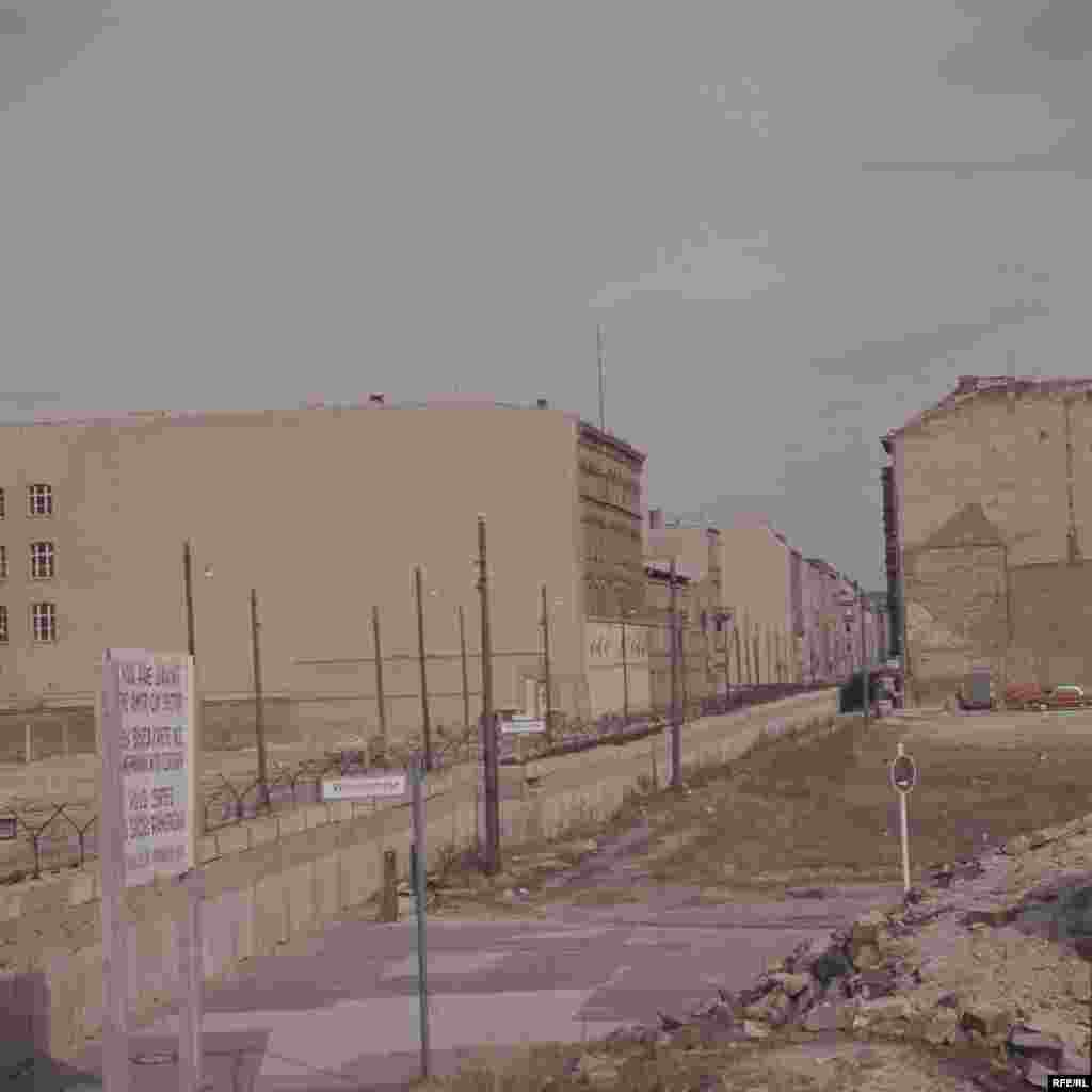 View of the newly constructed Berlin Wall, looking from West to East.On August 19, 1961, the wall claimed its first life as a man fell to his death trying to climb down from his top-floor apartment in East Berlin's Bernauerstrasse to the pavement below in West Berlin.