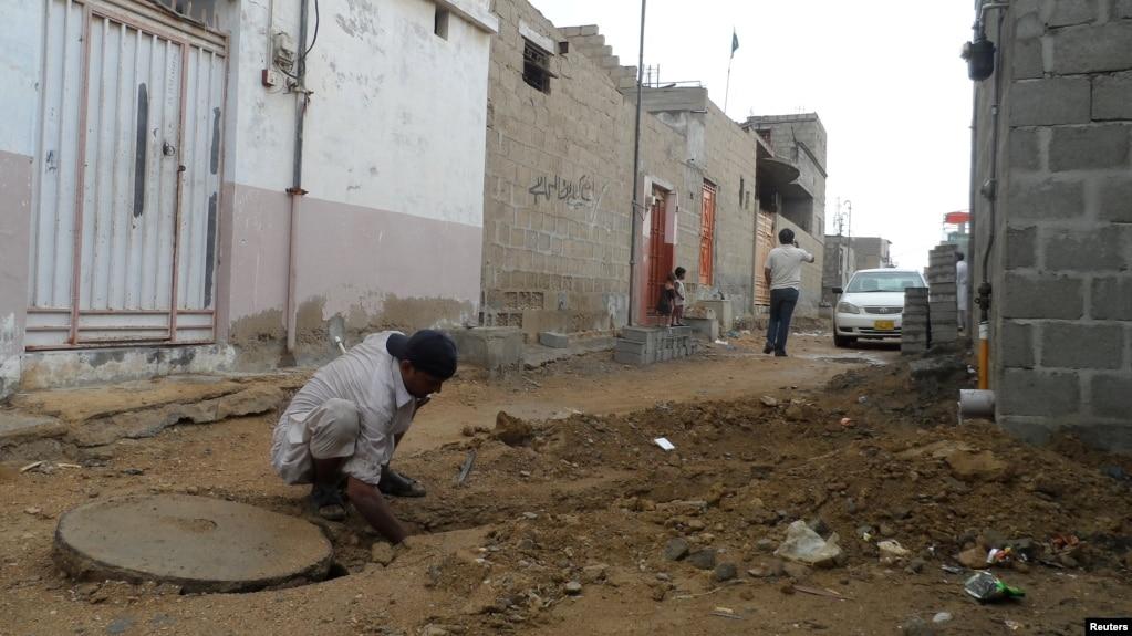 Pakistani Slum Takes On Sewer Problem