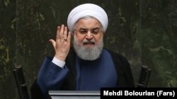 """Iranian President Hassan Rohani said it was """"absolutely clear to us who has done this."""" (file photo)"""