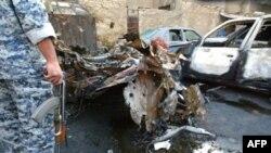 تصویری از محل یک انفجار در بغداد(عکس:AFP)