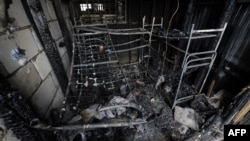 Charred bunk beds at the scene of a deadly fire in the Kachalovsky construction market on the outskirts of Moscow, which killed 17 people
