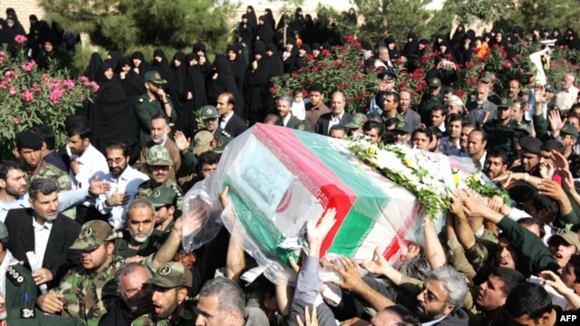Iranians carry the coffin of General Nourali Shoushtari, one of the Revolutionary Guards commanders killed in the suicide attack claimed by Jundallah.