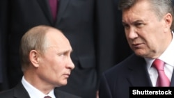 Президент России Владимир Путин и экс-президент Украины Виктор Янукович. Киев, июль 2013 года