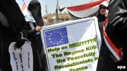 Female antiregime protesters hold a banner during a demonstration in Sanaa on April 6.