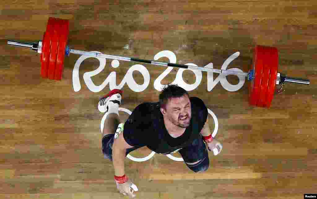 Vadzim Straltsou of Belarus competes in the men's weightlifting 94-kilogram final.