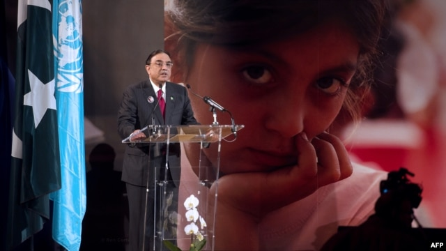 "Pakistani President Asif Ali Zardari delivers a speech during the ""Stand Up For Malala"" event in Paris on December 10."