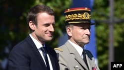 French President Emmanuel Macron (L) and Chief of the Defense Staff, French Army General Pierre de Villiers Paris, July 14, 2017