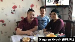 Sanat Dosov (left) is back home with his wife and son on December 11.