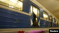 Flowers are left on the platform at the subway station in Minsk where 13 were killed.