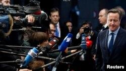 Ұлыбритания премьер-министрі Дэвид Кэмерон БАҚ өкілдеріне сұхбат беріп тұр. Брюссель, 18 желтоқсан 2014 жыл.