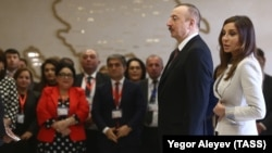 AZERBAIJAN -- Azerbaijani President Ilham Aliyev and his wife Mehriban arrive at a polling station in Baku, April 11, 2018